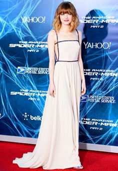 Emma Stone wears a nude slip dress with cutouts by Prada at the NYC premiere of The Amazing Spider-Man 2