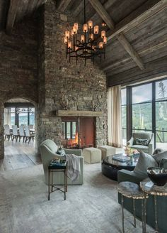 Stone and timber mountain dream house showcases Big Sky views - Home Professional Decoration Two Sided Fireplace, Home Fireplace, Living Room With Fireplace, Fireplace Stone, Living Rooms, Rustic Fireplaces, Fireplace Ideas, Living Room Decor Country, French Country Living Room