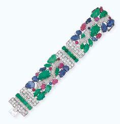 The famous Tutti-Frutti bracelet by Cartier; diamonds, emeralds and sapphires.  A legend.