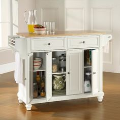 This may have to be a future purchase, my kitchen needs help!!!  Crosley Cambridge Kitchen Island with Natural Wood Top in White - note added... I love the little spice shelf on the end with the towel holder under it!