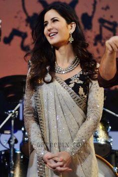 Indian diva Katrina Kaif in Sabyasachi saree at Kalaghoda festival 2016. She looks gorgeous in mirror work saree with black embroidery blouse.