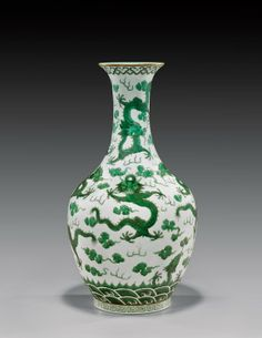 Antique Chinese porcelain vase; with design of green enameled dragons amid clouds; Daoguang coral red seal mark but probably Guangxu Period; H: 13 1/2""