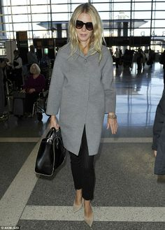 Back to it! Gwyneth Paltrow arrived at LAX on Tuesday to board yet another long haul flight to London looking sleepy but comfortable in her ...