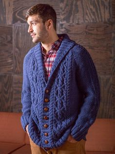 Fitzgerald is an Aran-style cardigan with a shawl collar and raglan shoulders. Pattern is charted.