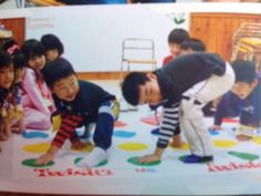twister game for physical , language and social development
