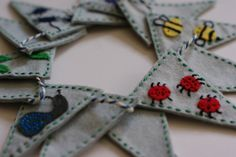 Miniature felt bunting with hand stitched insects