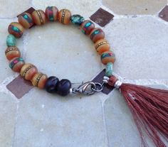 Tibetan Bone Bracelet with African Turquoise, Carved Wood and Indian Enlightenment Tassel. www.facebook.com/messyjewelry