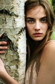 Female hugging tree