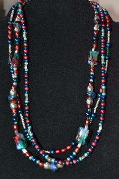 Triple strand-Multi color glass beads, additional Red, Green and Blue and silver beads with Silver accents.