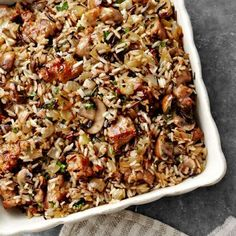 For this take on Thanksgiving dressing, two types of rice are cooked in a fragrant medley of mushrooms and onions sauteed in butter, bay leaf, and fresh sage.