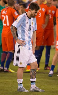 #COPA2016 #COPA100 Lionel Messi of Argentina looks down as Chile celebrates behind him following the championship match between Argentina and Chile at MetLife Stadium...