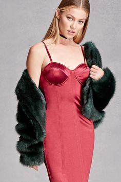 A satin slip dress featuring pintucks, padded cups, adjustable cami straps, and a concealed back zipper, and a bodycon silhouette. This is an independent brand and not a Forever 21 branded item.