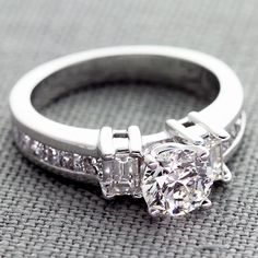 A Gorgeous 0.70 ct Round Diamond In Our 18K White Gold Baguette and Princess-Cut Diamond Ring