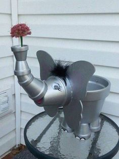 An elephant made out of silver painted terra cotta pots - cute!