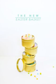 Gold tins with windows featured in Lovely Indeed's take on Modern Easter Baskets post. We love it!