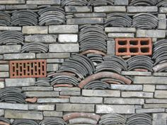 """Architect Wang Shu's Ningbo History Museum in Ningbo, China incorporates """"Wa Pan"""" into its exterior; a traditional building technique that uses found material fragments."""