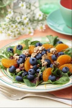 Blueberry breakfast salad, from Lynn's Paradise Café, Louisville, Kentucky -- greens, blueberries, oranges and granola, tossed with blueberry vinaigrette