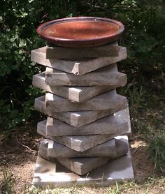 Changed block paths, leftover pavers. Decided to store them vertically as a birdbath. (Put a handful of fine sand between each for sturdiness. Level each layer as you build).