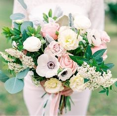 Blush & white loose bouquet with anemone, lisianthis, roses, eucalyptus, and ranunculus by Blush & Vine