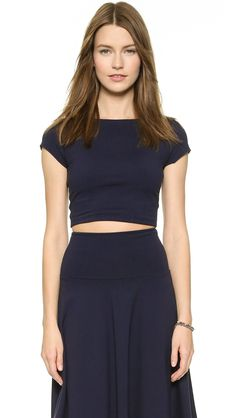 ¡Cómpralo ya!. Susana Monaco Short Sleeve Crop Top - Midnight. A formfitting Susana Monaco crop top with a classic scoop neckline. Short sleeves. Double layered. Fabric: Stretch jersey. 86% nylon/14% lycra spandex. Wash cold. Made in the USA. Measurements Length: 13.75in / 35cm, from shoulder Measurements from size S. Available sizes: M , topcorto, croptops, croptop, croptops, croptop, topcrop, topscrops, cropped, topbailarina, corto, camisolacorta, crop, croppedt-shirt, kurzestop…