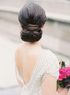 Elegant chignon: http://www.stylemepretty.com/2016/04/19/jewel-tone-wedding-palette-see-how-its-done/ | Photography: Clary Pfeiffer - http://claryphoto.com/