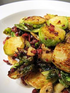 Crispy Brussels sprouts with bacon & garlic.  Sweet, garlicky and the most important taste groups, bacony!