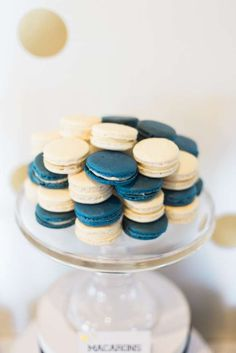 Macarons at a navy and gold baby shower! See more party planning ideas at CatchMyParty.com!