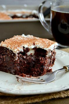 Kahlua Tiramisu Poke Cake- Chocolate and espresso are a match made in dessert heaven. This poke cake is amazingly easy and oh so scrumptious.
