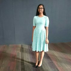 Raveena wearing Omika's turquoise knee length dress, Nicole.