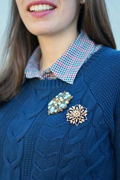 brooches on a sweater