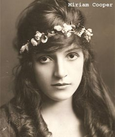 """Miriam Cooper (1891 - 1976) was a silent film actress who is best known for her work in early film including (the now reviled) """"Birth of a Nation"""" and """"Intolerance"""" for D. W. Griffith, and The Honor System and Evangeline for her husband Raoul Walsh. She retired from acting in 1923 but was rediscovered by the film community in the 1960s, and toured colleges lecturing about silent films."""