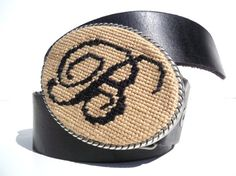 Needlepoint belt buckle.