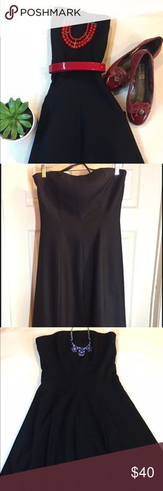 Little black strappless dress Beautiful and in Excellent condition Black Dress. Comes from a smoke free, pet free home.   Details: Brand: J.Crew Color: Black Size: 4 Materials: 40%wool, 28%rayon, 27%polyester, 5%Spandex                   Lining 100%acetate Measures: Bust approx. 35in, waist:Approx.28in. Dress length                   from bust to hem: Approx. 37in J. Crew Dresses Strapless