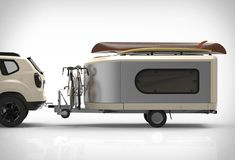 Tipoon is a modular, mobile, lightweight camper that grows to 3 times its size at the push of a button! The sleek trailer tows at roughly vehicle height, but the moment you get to camp, it expands out into a cozy tiny home. It comes wit