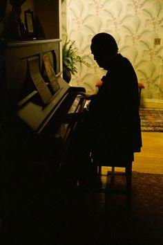 Marlon Brando sitting at the piano.