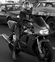 ... motorcycle girl.. that's hot, and impressive... she's riding in heals!