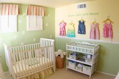 Designer's Notes: Most likely, your baby girl will be showered with beautifully patterned and colorful clothing, so don't hide them in the closet. Outfits will be much easier to select if they are in full view. Hang them on pretty hooks and create an original art piece that is functional and fun to change.