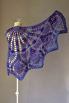 Pattern Information Pineapple Peacock Shawl Designed by Amy Gunderson    PATTERN NOTES  This half-circle shawl is worked from the center out. A picot border is added around the entire outer edge of the shawl at the end.    Free pattern via Universal Yarn