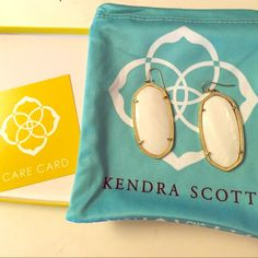Kendra Scott Danielle earrings Perfect condition earrings come with everything in picture. White with gold Kendra Scott Jewelry Earrings