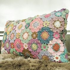 My finished flower pillow, picture taken in the oddest light.   by Alicebyday