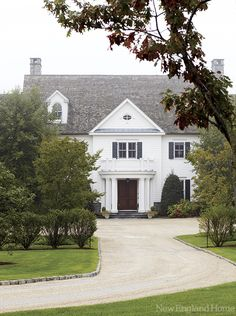 The home's facade is grand, inviting and traditional.
