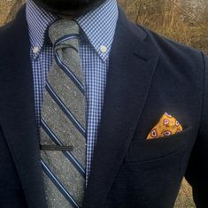 Elevate your blues with a statement yellow paisley pocket square.