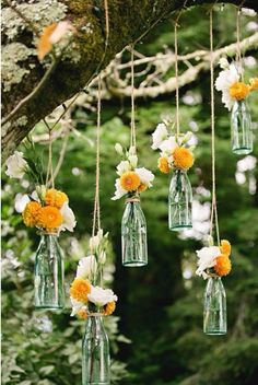 hanging flowers for outdoor wedding ceremony / reception decor. Suspend clear so. hanging flowers for outdoor wedding ceremony / reception decor. Suspend clear soda bottles from tree branches with jute / rustic twine. Diy Wedding, Dream Wedding, Wedding Day, Wedding Trends, Wedding Blog, Wedding Yellow, Wedding Table, Trendy Wedding, Floral Wedding