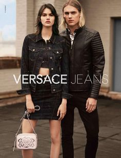 After appearing in Etro's colorful spring 2015 campaign, model Ton Heukels lands another advertisement, connecting with Versace Jeans for its newest outing. Heading outdoors, Ton poses for a simple photo with Vanessa Moody. Photographed by Alessio Boni and outfitted by stylist Alastair McKimm, Ton embraces black, wearing a Versace moto-style leather jacket with skinny black denim jeans. Related