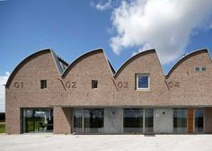 Warehouse with sawtooth roof pays tribute to a mill by Gerrit Rietveld.