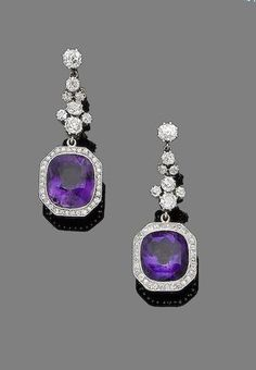 A pair of amethyst and diamond pendent earrings Each mixed-cut cushion-shaped amethyst within a single-cut diamond surround suspended from a cushion-shaped diamond surmount, diamonds approx. total, length cased by Bloom & Son Ltd, London by AislingH Purple Jewelry, Amethyst Jewelry, Amethyst Earrings, I Love Jewelry, Diamond Earrings, Fine Jewelry, Pendant Earrings, Diamond Pendant, Jewelry Rings
