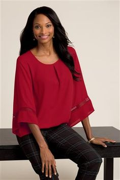 Item #: 48089 Angel Sleeve Blouse: A front inverted pleat and 3/4 bell sleeves with an intricate cutout detail lend this piece its classic, feminine look. The elasticized hem ensures an elegant drape.