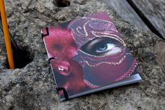 The Red Mask Notebook by birddoodle on Etsy, $10.00