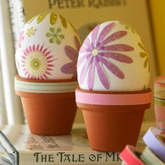 Scrapbook stickers and mini terra-cotta pots set a floral scene for this Easter egg decoration: http://www.bhg.com/holidays/easter/eggs/pretty-no-dye-easter-eggs/?socsrc=bhgpin032815pottedplantseastereggs&page=3