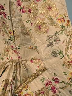 Detail of 18th Century sacque gown. Silk brocade and gold thread.  [augusta-auctions]